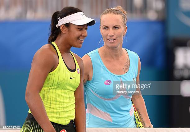 Svetlana Kuznetsova of Russia chats with Destanee Aiava of Australia after their match on day four of the 2017 Brisbane International at Pat Rafter...