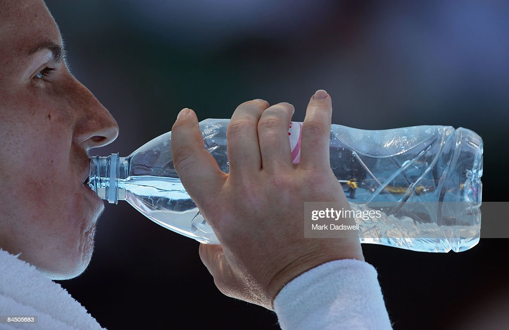 Svetlana Kuznetsova of Russia drinks a bottle of water between games in her quarterfinal match against Serena Williams of the United States of...