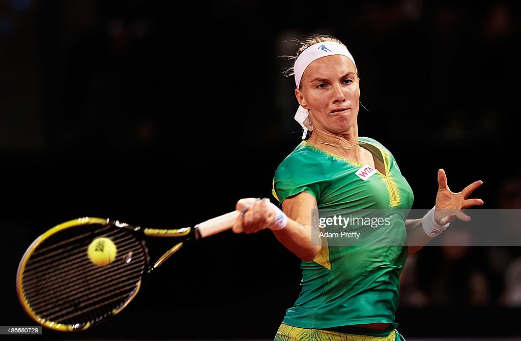 <a gi-track='captionPersonalityLinkClicked' href=/galleries/search?phrase=Svetlana+Kuznetsova&family=editorial&specificpeople=167249 ng-click='$event.stopPropagation()'>Svetlana Kuznetsova</a> of Russia hits a forehand during her match against Ana Ivanovic of Serbia on day five of the Porsche Tennis Grand Prix at Porsche Arena on April 25, 2014 in Stuttgart, Germany.