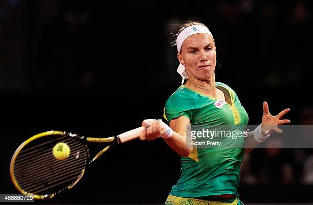 Svetlana Kuznetsova of Russia hits a forehand during her match against Ana Ivanovic of Serbia on day five of the Porsche Tennis Grand Prix at Porsche...