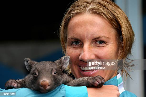Svetlana Kuznetsova of Russia holds a baby wombat during day five of the 2013 Australian Open at Melbourne Park on January 18 2013 in Melbourne...