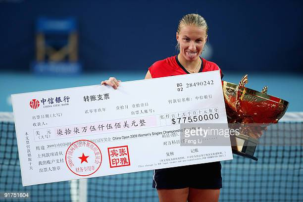 Svetlana Kuznetsova of Russia holds the prize money cheque and her trophy after victory in the women's final match during day ten of the 2009 China...