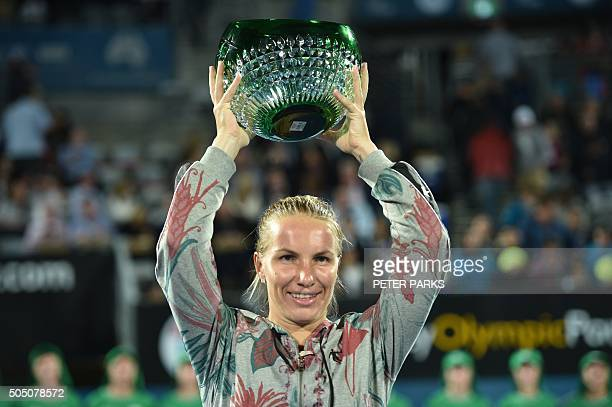 Svetlana Kuznetsova of Russia holds the trophy after her victory over Monica Puig of Puerto Rico 60 62 in the women's final match at the Sydney...