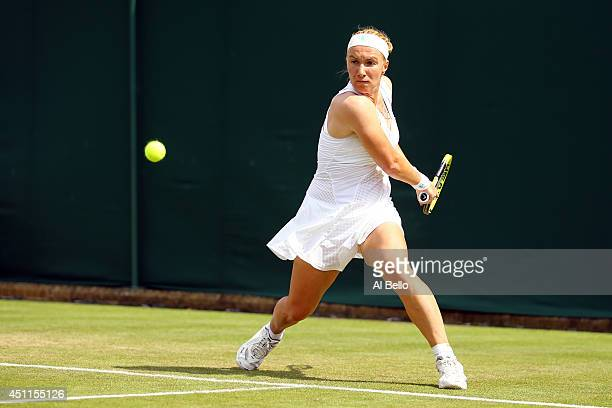 Svetlana Kuznetsova of Russia in action during her Ladies' Singles first round match against Michelle Larcher De Brito of Portugal on day two of the...