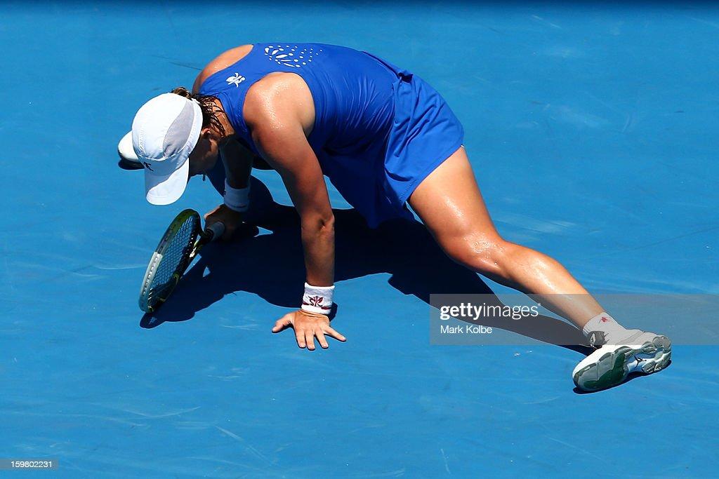 Svetlana Kuznetsova of Russia lands heavily in her fourth round match against Caroline Wozniacki of Denmark during day eight of the 2013 Australian Open at Melbourne Park on January 21, 2013 in Melbourne, Australia.