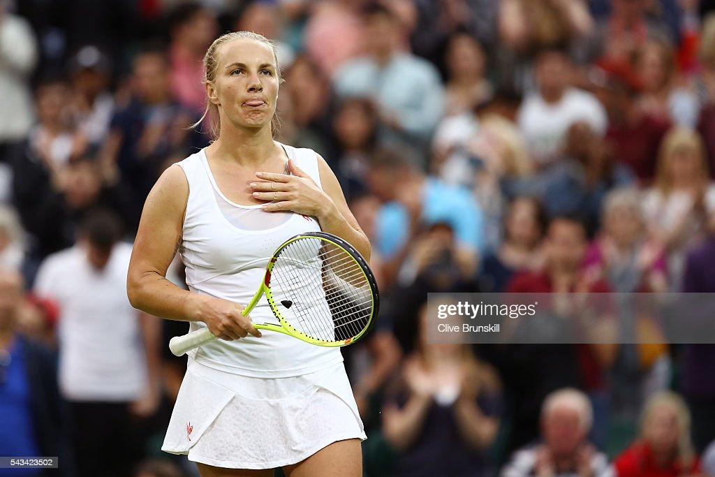 <a gi-track='captionPersonalityLinkClicked' href=/galleries/search?phrase=Svetlana+Kuznetsova&family=editorial&specificpeople=167249 ng-click='$event.stopPropagation()'>Svetlana Kuznetsova</a> of Russia looks on during the Ladies Singles first round match against Caroline Wozniacki of Denmark on day two of the Wimbledon Lawn Tennis Championships at the All England Lawn Tennis and Croquet Club on June 28, 2016 in London, England.