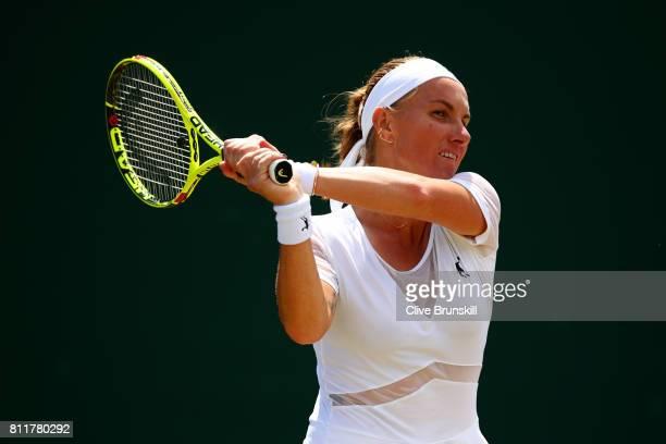 Svetlana Kuznetsova of Russia plays a backhand during the Ladies Singles fourth round match against Agnieszka Radwanska of Poland on day seven of the...