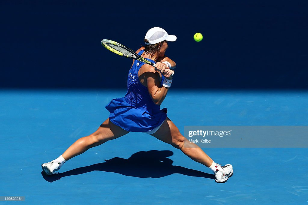 Svetlana Kuznetsova of Russia plays a backhand in her fourth round match against Caroline Wozniacki of Denmark during day eight of the 2013 Australian Open at Melbourne Park on January 21, 2013 in Melbourne, Australia.