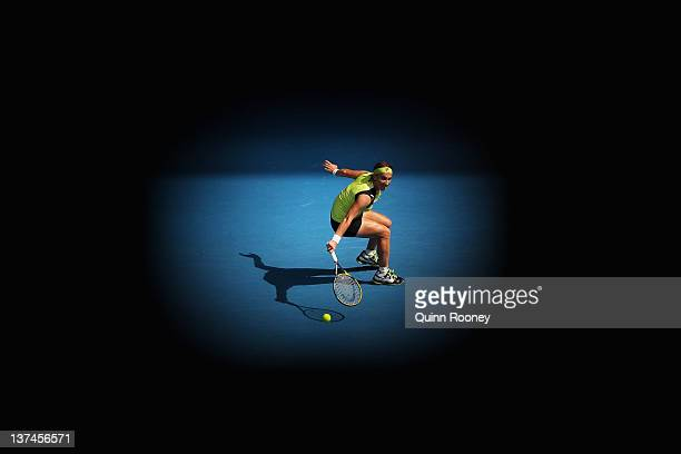 Svetlana Kuznetsova of Russia plays a backhand in her third round match against Sabine Lisicki of Germany during day six of the 2012 Australian Open...