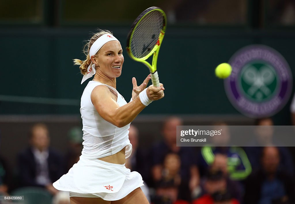 <a gi-track='captionPersonalityLinkClicked' href=/galleries/search?phrase=Svetlana+Kuznetsova&family=editorial&specificpeople=167249 ng-click='$event.stopPropagation()'>Svetlana Kuznetsova</a> of Russia plays a forehand during the Ladies Singles first round match against Caroline Wozniacki of Denmark on day two of the Wimbledon Lawn Tennis Championships at the All England Lawn Tennis and Croquet Club on June 28, 2016 in London, England.