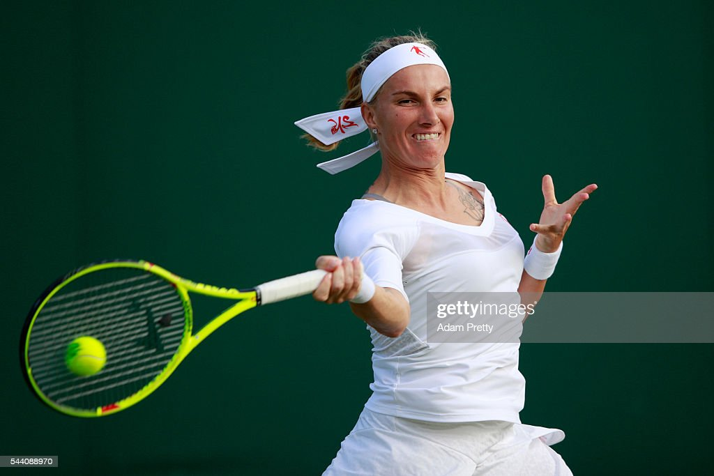 <a gi-track='captionPersonalityLinkClicked' href=/galleries/search?phrase=Svetlana+Kuznetsova&family=editorial&specificpeople=167249 ng-click='$event.stopPropagation()'>Svetlana Kuznetsova</a> of Russia plays a forehand during the Ladies Singles second round match against Tara moore of Great Britain on day five of the Wimbledon Lawn Tennis Championships at the All England Lawn Tennis and Croquet Club on July 1, 2016 in London, England.