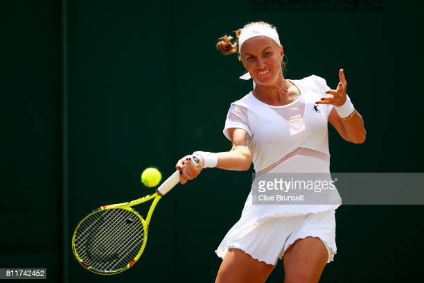 Svetlana Kuznetsova of Russia plays a forehand during the Ladies Singles fourth round match against Agnieszka Radwanska of Poland on day seven of the...