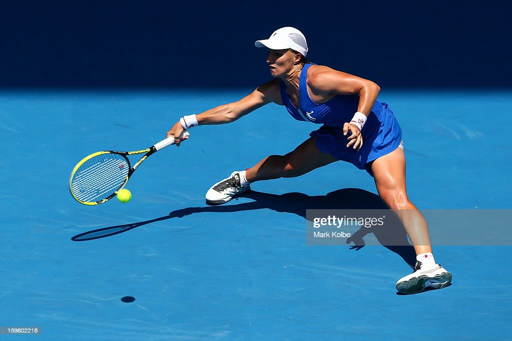 Svetlana Kuznetsova of Russia plays a forehand in her fourth round match against Caroline Wozniacki of Denmark during day eight of the 2013 Australian Open at Melbourne Park on January 21, 2013 in Melbourne, Australia.