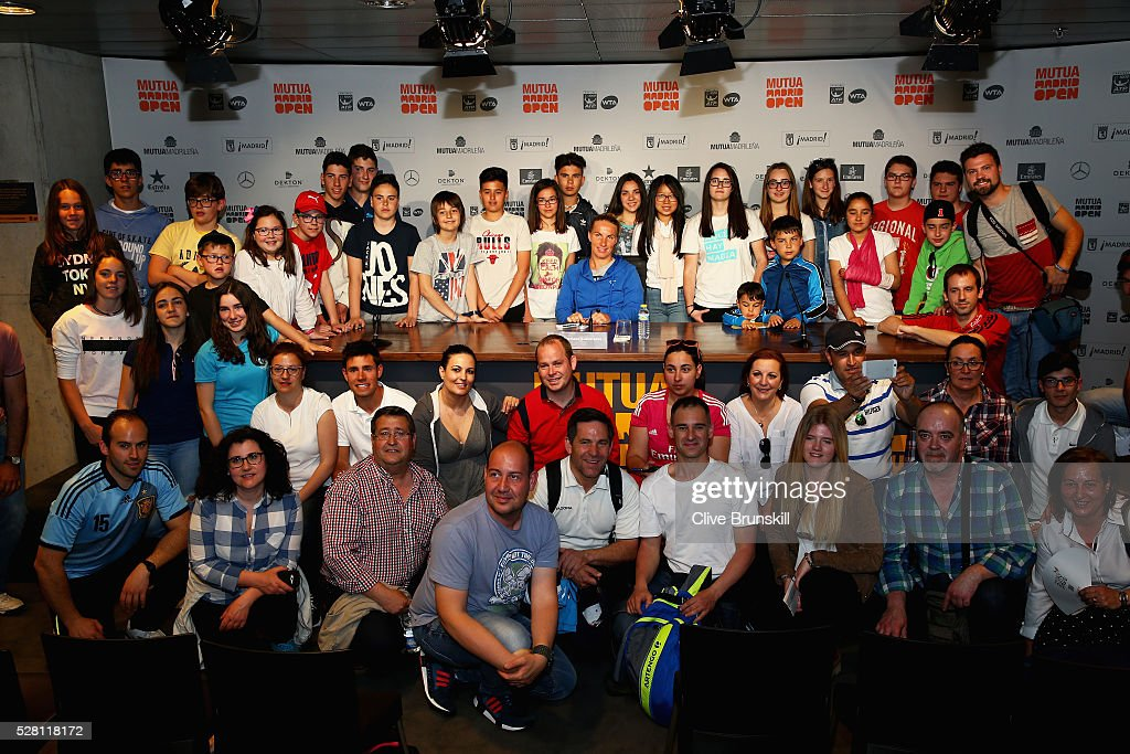 Svetlana Kuznetsova of Russia poses for a group photograph after holding a press conference for young children to ask their questions to her during day five of the Mutua Madrid Open tennis tournament at the Caja Magica on May 04, 2016 in Madrid.