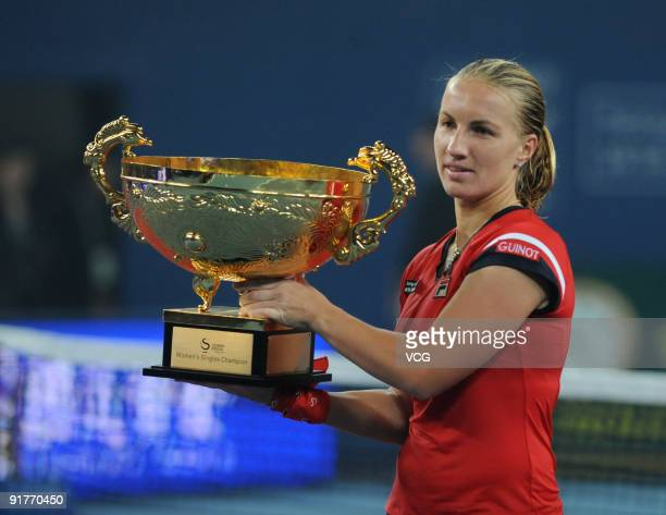 Svetlana Kuznetsova of Russia poses with her trophy after victory in the women's final match against Agnieszka Radwanska on day ten of the 2009 China...