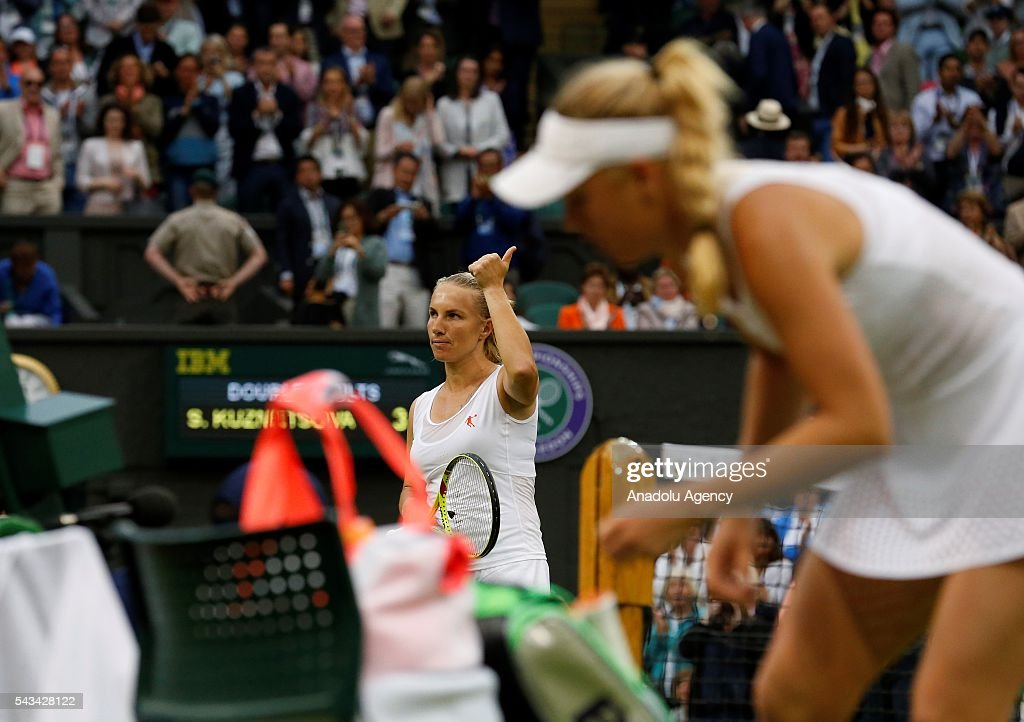 Svetlana Kuznetsova (L) of Russia reacts after Women's Singles on day two of the 2016 Wimbledon Championships match against Caroline Wozniacki (R) of Denmark at the All England Lawn and Croquet Club in London, United Kingdom on June 28, 2016.
