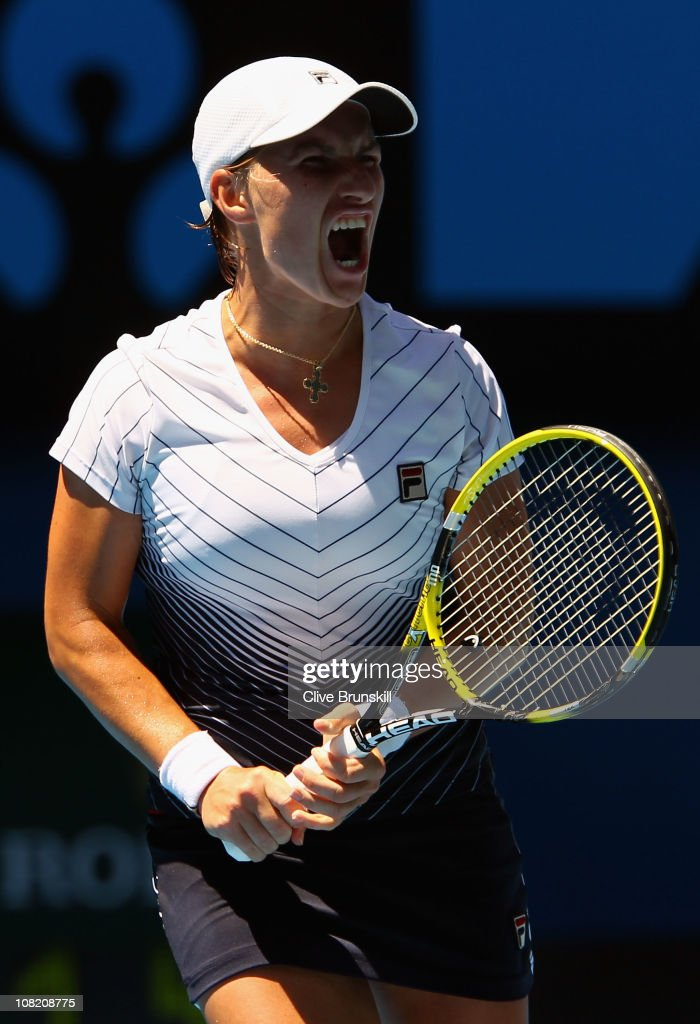<a gi-track='captionPersonalityLinkClicked' href=/galleries/search?phrase=Svetlana+Kuznetsova&family=editorial&specificpeople=167249 ng-click='$event.stopPropagation()'>Svetlana Kuznetsova</a> of Russia reacts in her third round match against Justine Henin of Belgium during day five of the 2011 Australian Open at Melbourne Park on January 21, 2011 in Melbourne, Australia.