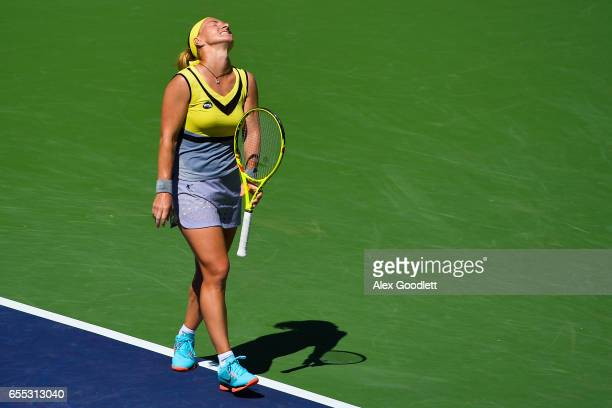 Svetlana Kuznetsova of Russia reacts to a shot against Elena Vesnina of Russia in the women's final on day 14 during the BNP Paribas Open at Indian...