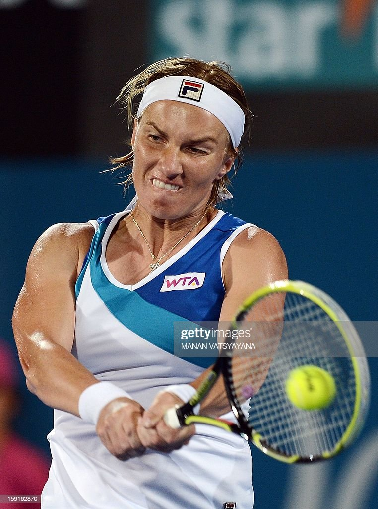 Svetlana Kuznetsova of Russia returns a shot against Angelique Kerber of Germany during their quarter-final match of the Sydney International tennis tournament on January 9, 2013. AFP PHOTO/ MANAN VATSYAYANA USE