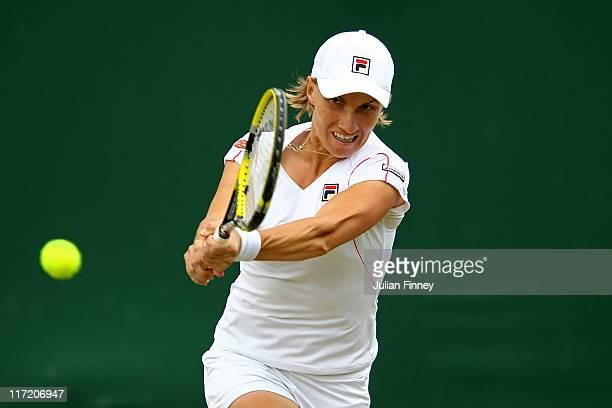 Svetlana Kuznetsova of Russia returns a shot during her third round match against Yanina Wickmayer of Belgium on Day Five of the Wimbledon Lawn...
