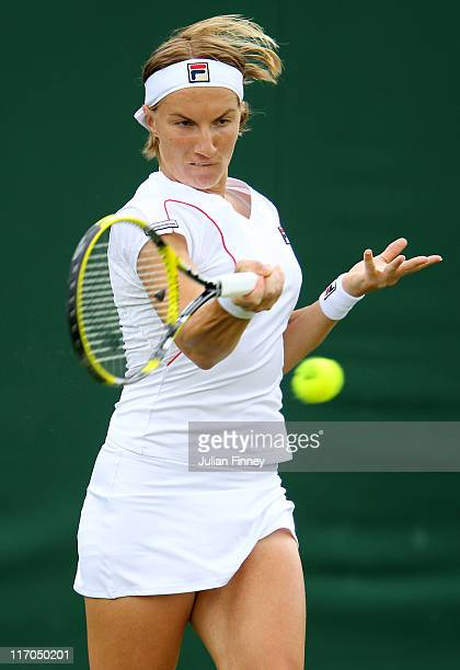 Svetlana Kuznetsova of Russia returns a shot during the first round match against Zhang Shuai of China on Day One of the Wimbledon Lawn Tennis...
