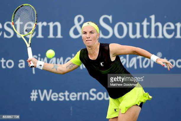 Svetlana Kuznetsova of Russia returns a shot to Carla Suarez Navarro of Spain during day 6 of the Western Southern Open at the Lindner Family Tennis...