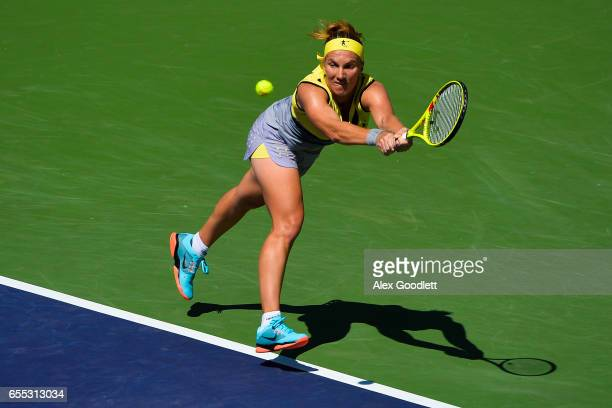 Svetlana Kuznetsova of Russia returns a shot to Elena Vesnina of Russia in the women's final on day 14 during the BNP Paribas Open at Indian Wells...