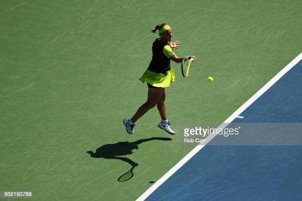 Svetlana Kuznetsova of Russia returns a shot to Garbine Muguruza of Spain during Day 7 of the Western and Southern Open at the Linder Family Tennis...