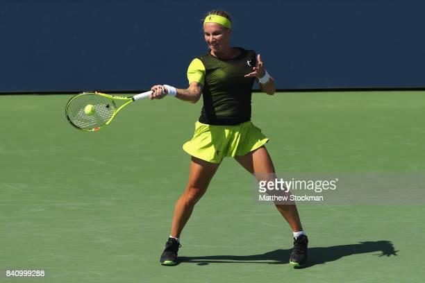 Svetlana Kuznetsova of Russia returns a shot to Marketa Vondrousova of the Czech Republic during their first round Women's Singles match on Day Three...