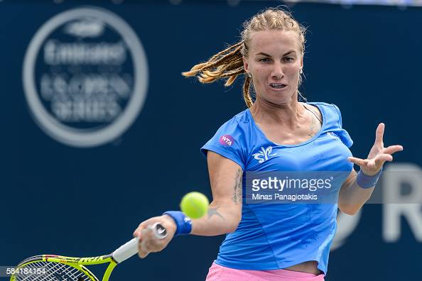 Svetlana Kuznetsova of Russia returns the ball against Petra Kvitova of Czech Republic during day four of the Rogers Cup at Uniprix Stadium on July...