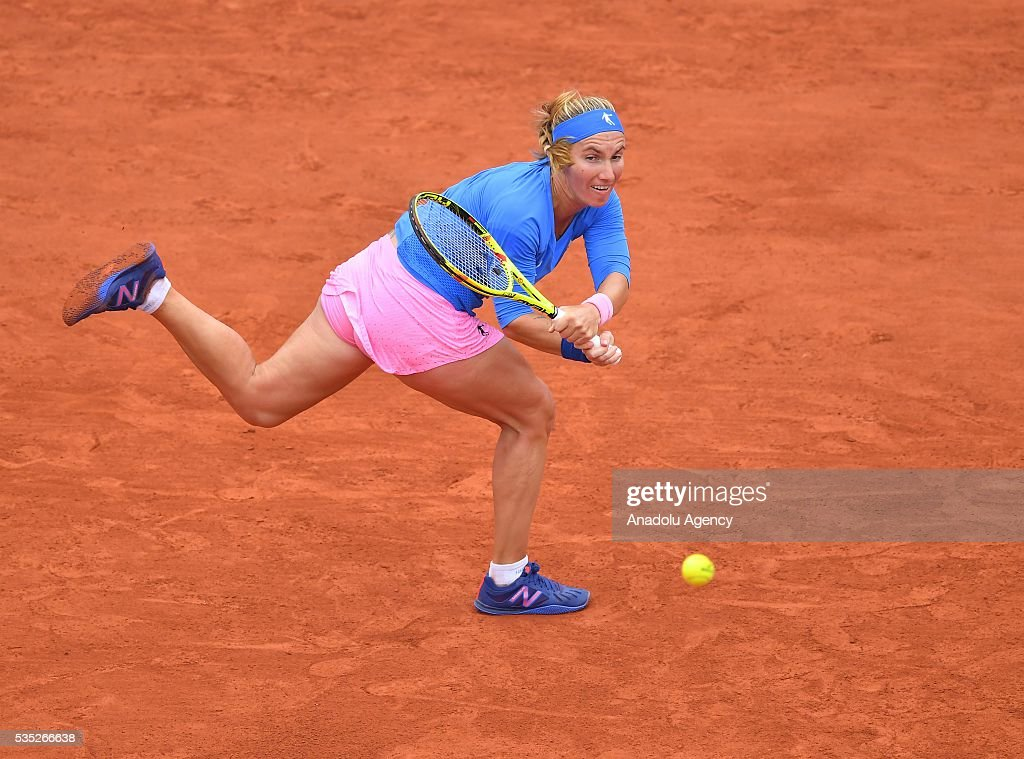 Svetlana Kuznetsova of Russia returns to Garbine Muguruza (not seen) of Spain during the women's single fourth round match at the French Open tennis tournament at Roland Garros Stadium in Paris, France on May 29, 2016.