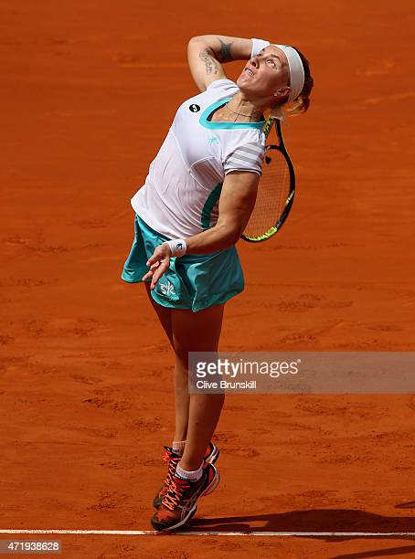 Svetlana Kuznetsova of Russia serves against Ekaterina Makarova of Russia in their first round match during day one of the Mutua Madrid Open tennis...