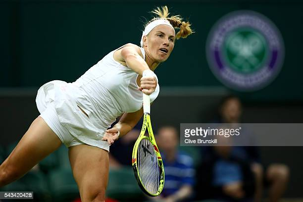 Svetlana Kuznetsova of Russia serves during the Ladies Singles first round match against Caroline Wozniacki of Denmark on day two of the Wimbledon...