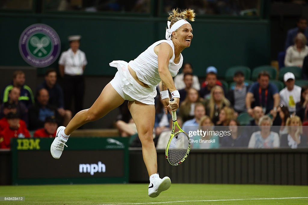 <a gi-track='captionPersonalityLinkClicked' href=/galleries/search?phrase=Svetlana+Kuznetsova&family=editorial&specificpeople=167249 ng-click='$event.stopPropagation()'>Svetlana Kuznetsova</a> of Russia serves during the Ladies Singles first round match against Caroline Wozniacki of Denmark on day two of the Wimbledon Lawn Tennis Championships at the All England Lawn Tennis and Croquet Club on June 28, 2016 in London, England.