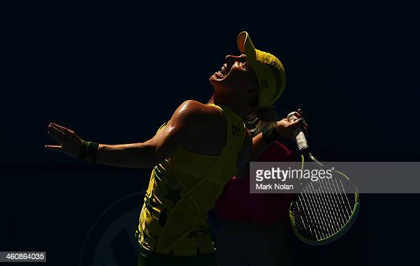 Svetlana Kuznetsova of Russia serves in her match against Varvara Lepchenko of the USA during day two of the Sydney International at Sydney Olympic...