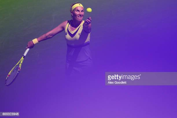 Svetlana Kuznetsova of Russia serves to Elena Vesnina of Russia in the women's final on day 14 during the BNP Paribas Open at Indian Wells Tennis...