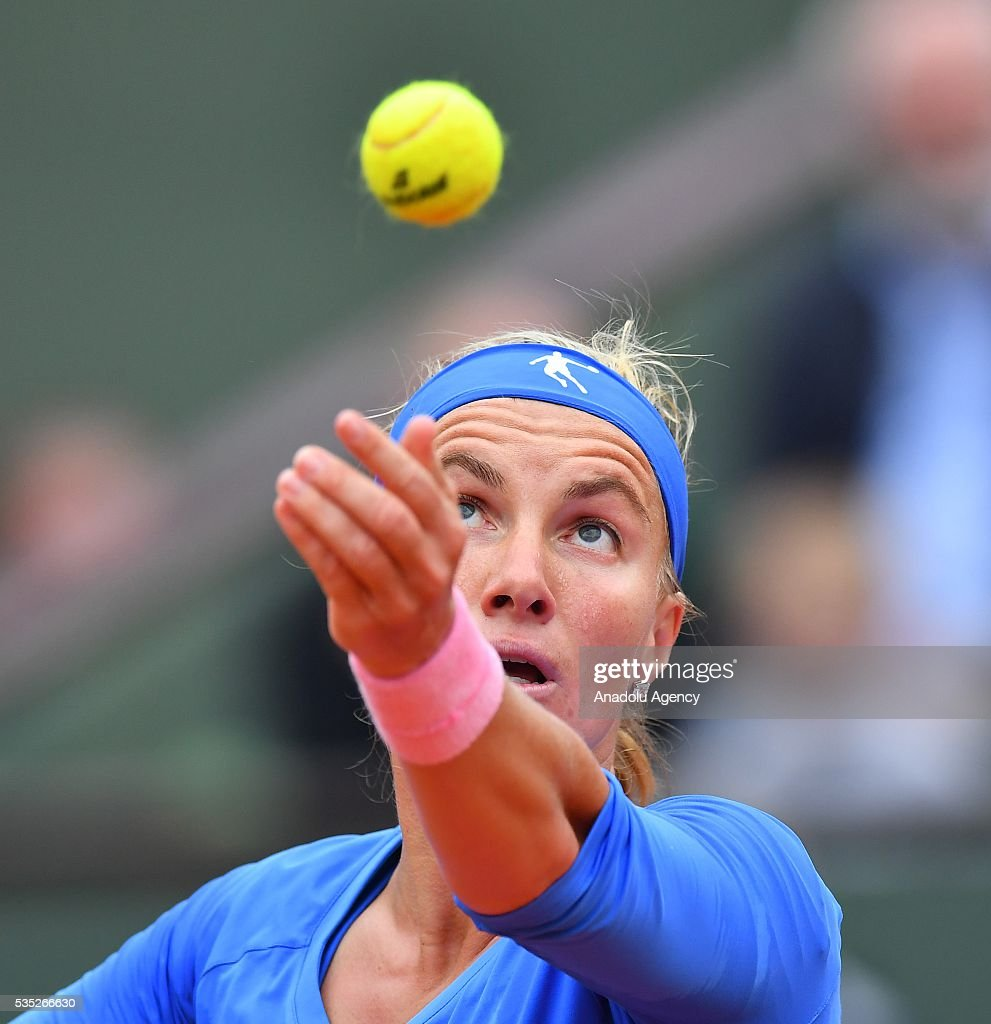Svetlana Kuznetsova of Russia serves to Garbine Muguruza (not seen) of Spain during the women's single fourth round match at the French Open tennis tournament at Roland Garros Stadium in Paris, France on May 29, 2016.