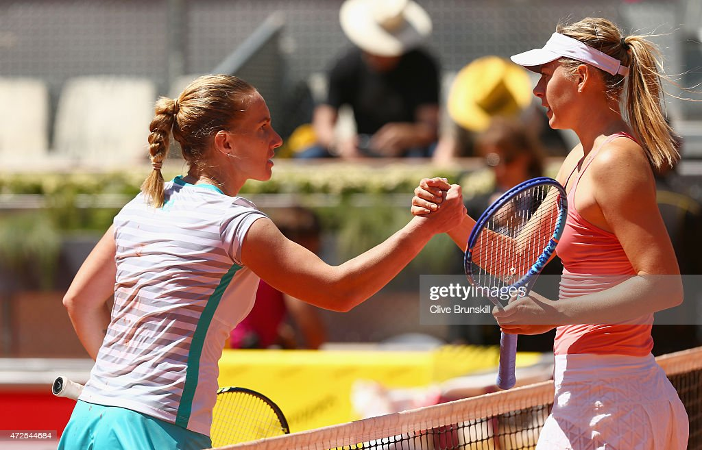 <a gi-track='captionPersonalityLinkClicked' href=/galleries/search?phrase=Svetlana+Kuznetsova&family=editorial&specificpeople=167249 ng-click='$event.stopPropagation()'>Svetlana Kuznetsova</a> of Russia shakes hands at the net after her straight sets victory against Maria Sharapova of Russia in their semi final match during day seven of the Mutua Madrid Open tennis tournament at the Caja Magica on May 8, 2015 in Madrid, Spain.