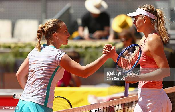 Svetlana Kuznetsova of Russia shakes hands at the net after her straight sets victory against Maria Sharapova of Russia in their semi final match...