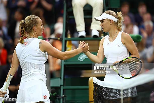 Svetlana Kuznetsova of Russia shakes hands with Caroline Wozniacki of Denmark following victory in the Ladies Singles first round match on day two of...