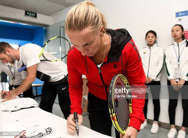 Svetlana Kuznetsova of Russia signs an autograph before the MercedesBenz Kids event during day 1 of the 2017 China Open at the China National Tennis...