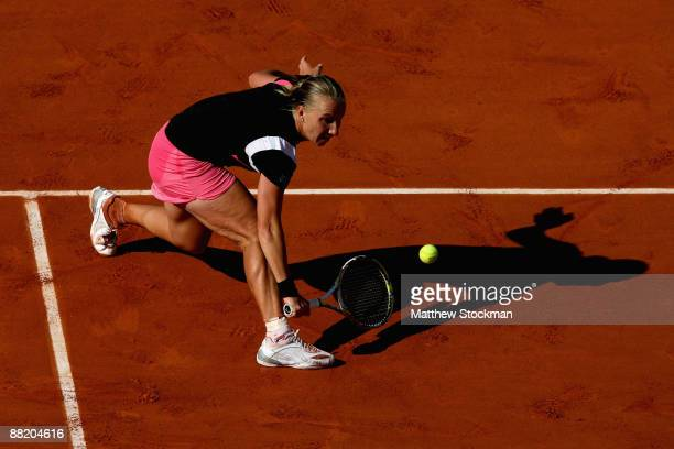 Svetlana Kuznetsova of Russia stretches for a backhand during the Women's Singles Semi Final match against Samantha Stosur of Australia on day Twelve...