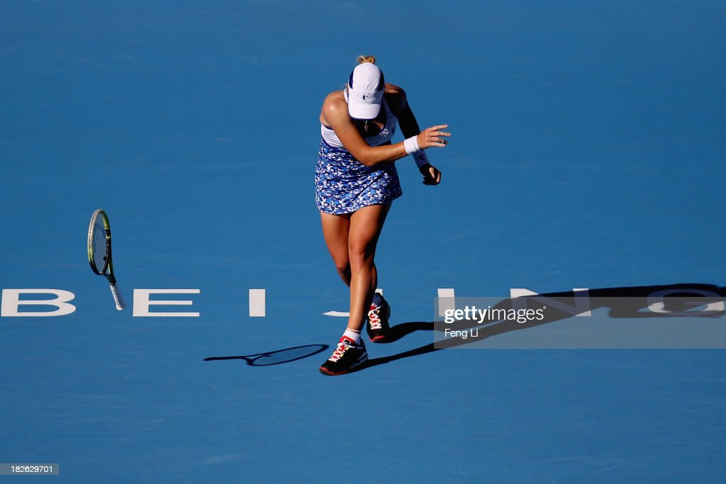 <a gi-track='captionPersonalityLinkClicked' href=/galleries/search?phrase=Svetlana+Kuznetsova&family=editorial&specificpeople=167249 ng-click='$event.stopPropagation()'>Svetlana Kuznetsova</a> of Russia throw away the racket during her women's singles match against Andrea Petkovic of Germany on day five of the 2013 China Open at the National Tennis Center on October 2, 2013 in Beijing, China.