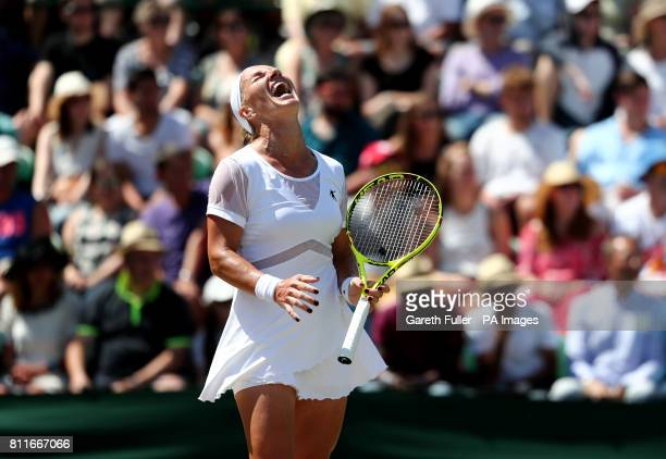 Svetlana Kuznetsova reacts during her match against Agnieszka Radwanska on day seven of the Wimbledon Championships at The All England Lawn Tennis...