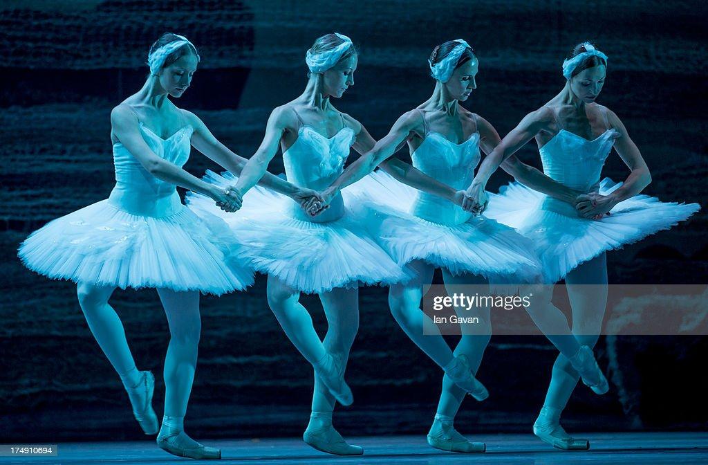 Svetlana Pavlova, Mararita Shrainer, Yulia Lunkina and Anna Voronkova of the Bolshoi Ballet perform during a photocall for 'Swan Lake' at The Royal Opera House on July 29, 2013 in London, England.