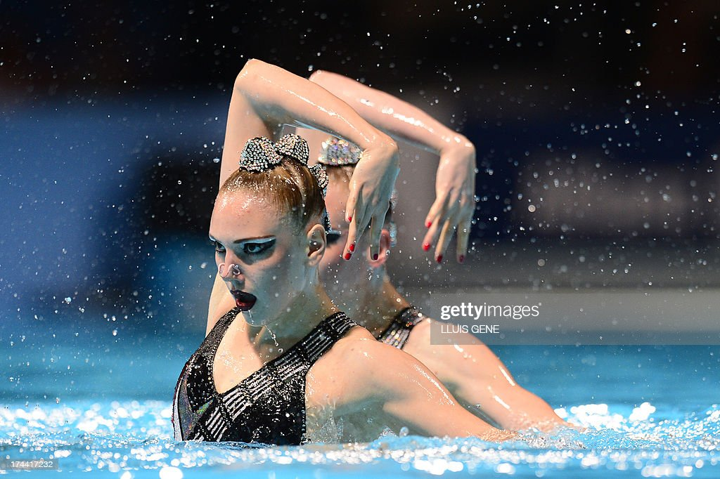 Svetlana Romashina and Russia's <a gi-track='captionPersonalityLinkClicked' href=/galleries/search?phrase=Svetlana+Kolesnichenko&family=editorial&specificpeople=7986692 ng-click='$event.stopPropagation()'>Svetlana Kolesnichenko</a> compete in the duet free final during the synchronised swimming competition in the FINA World Championships at the Palau Sant Jordi in Barcelona, on July 25, 2013. They won gold.