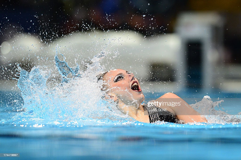 Svetlana Romashina and Russia's <a gi-track='captionPersonalityLinkClicked' href=/galleries/search?phrase=Svetlana+Kolesnichenko&family=editorial&specificpeople=7986692 ng-click='$event.stopPropagation()'>Svetlana Kolesnichenko</a> compete in the duet free final during the synchronised swimming competition in the FINA World Championships at the Palau Sant Jordi in Barcelona, on July 25, 2013.