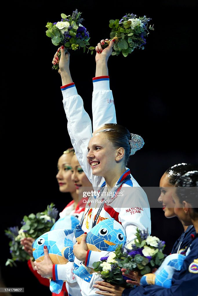 <a gi-track='captionPersonalityLinkClicked' href=/galleries/search?phrase=Svetlana+Romashina&family=editorial&specificpeople=5988166 ng-click='$event.stopPropagation()'>Svetlana Romashina</a> and <a gi-track='captionPersonalityLinkClicked' href=/galleries/search?phrase=Svetlana+Kolesnichenko&family=editorial&specificpeople=7986692 ng-click='$event.stopPropagation()'>Svetlana Kolesnichenko</a> of Russia pose with their gold medals after winning the Synchronized Swimming Duet Technical final on day two of the 15th FINA World Championships at Palau Sant Jordi on July 21, 2013 in Barcelona, Spain.