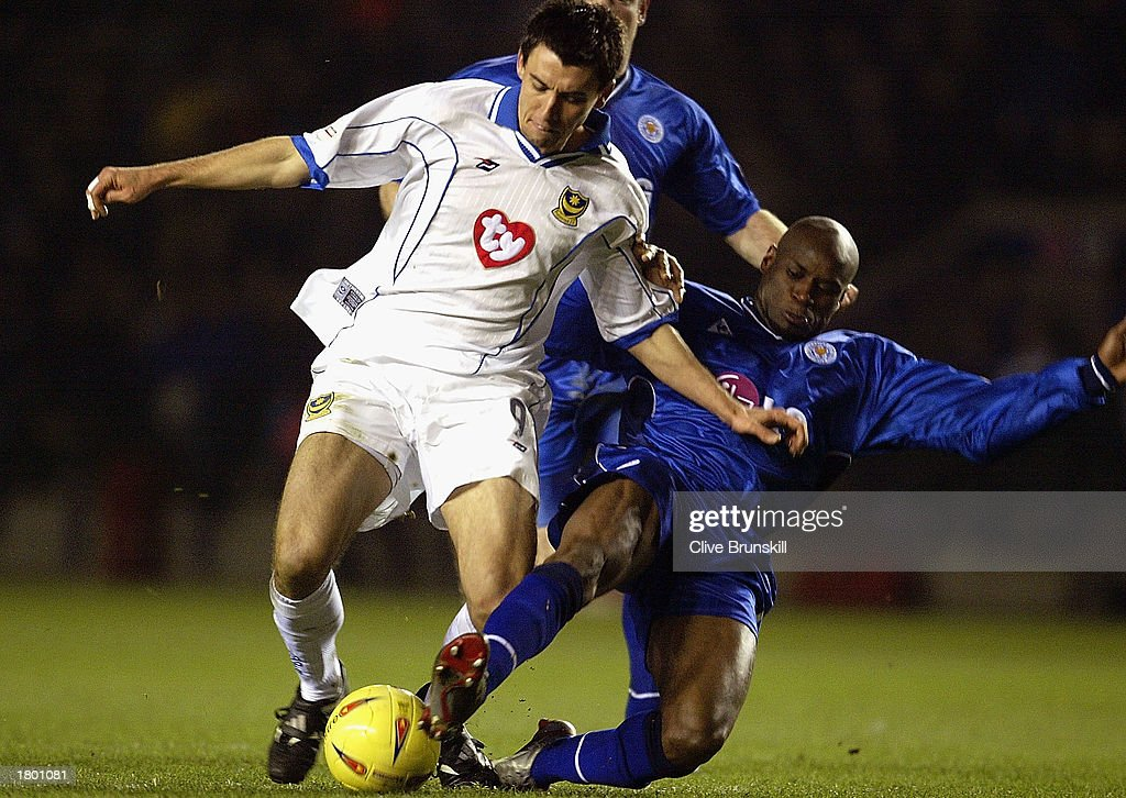Svetoslav Todorov of Portsmouth holds off Frank Sinclair of Leicester during the Nationwide League Division One match between Leicester City and Portsmouth at Walkers Stadium, Leicester, England on February 17, 2003.