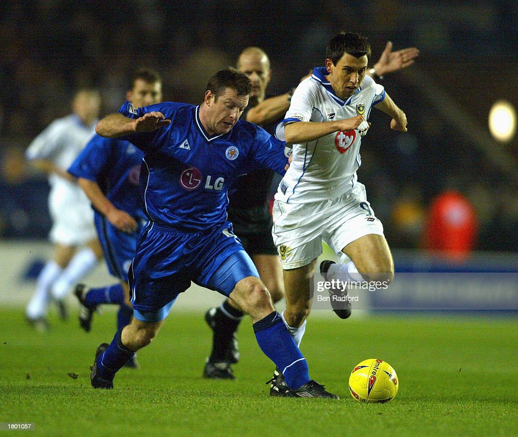 Svetoslav Todorov of Portsmouth holds off Gerry Taggart of Leicester during the Nationwide League Division One match between Leicester City and Portsmouth at Walkers Stadium, Leicester, England on February 17, 2003.